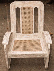 old wooden caned chair restored and repainted.